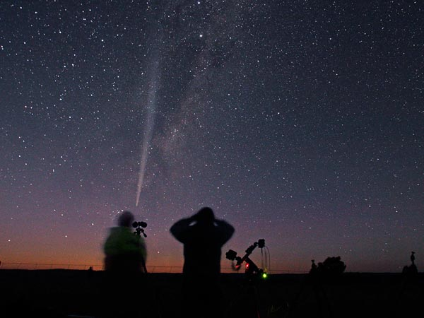 Sky-watchers in Australia ogle comet Lovejoy late last year.  Photograph by John Goldsmith, TWAN